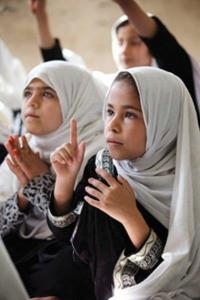 Adela in class at Charbagh-E-Safa Girls High School in Jalalabad.
