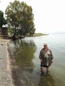 Jeni Goring wading in the sea of Galilee.