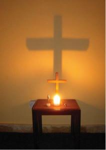 "Neville's Prayer Station in Iraq during the time  of the war. The candle was a gift from his congregation, Wembley Downs Uniting Church,  who told him to ""go and  be our light in Baghdad""."